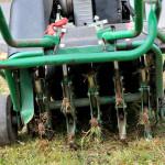 Lawn Aerator Working On A Yard In Distress
