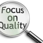 "Magnifying Glass with the text ""focus on quality"""