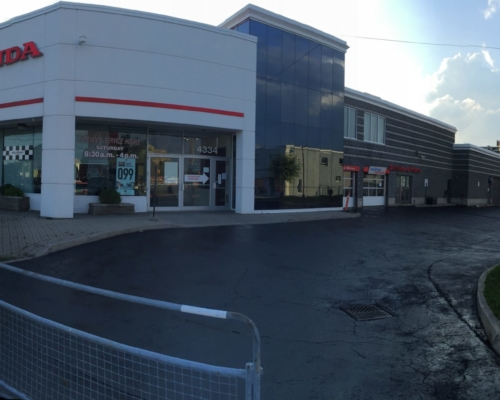 Image of Action Honda car dealership driveway after a full sealcoat was applied to their service driveway