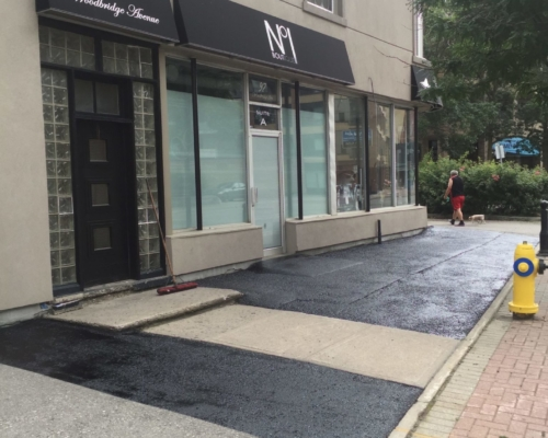 Freshly Applied Asphalt Sealant Outside of Small Business